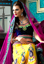 The traditional patterns used on this lehenga maintain the ethnic look. This yellow net a-line lehenga choli is nicely embroidered patch border is done with resham, zari, sequins, stone, beads and lace work. The beautiful embroidery on lehenga made it awesome and gives you stylish and attractive look to others. Contrasting navy blue velvet choli and dark pink net dupatta is availble with this lehenga. Slight Color variations are possible due to differing screen and photograph resolutions.