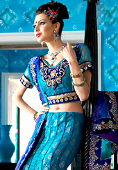 Welcome to the new era of Indian fashion wear. This blue net a-line lehenga choli is nicely embroidered patch border is done with resham, zari, sequins, stone and lace work. The beautiful embroidery on lehenga made it awesome and gives you stylish and attractive look to others. Matching choli and dupatta is availble with this lehenga. Slight Color variations are possible due to differing screen and photograph resolutions.