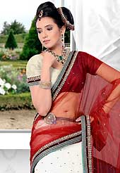 Outfit is a novel ways of getting yourself noticed. This white net lehenga is nicely embroidered patch work is done with resham, zari, stone and lace work. The beautiful embroidery on lehenga made it awesome and gives you stylish and attractive look to others. Matching choli and maroon net dupatta is availble with this lehenga. Slight Color variations are possible due to differing screen and photograph resolutions.