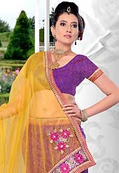 Make your collection more attractive and charming with this impressive dress. This purple net lehenga is nicely embroidered patch work is done with resham, zari, stone and lace work. The beautiful embroidery on lehenga made it awesome and gives you stylish and attractive look to others. Matching choli and yellow net dupatta is availble with this lehenga. Slight Color variations are possible due to differing screen and photograph resolutions.