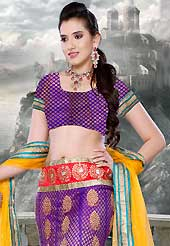 An occasion wear perfect is ready to rock you. This purple net lehenga is nicely embroidered patch work is done with zari, stone and lace work. The beautiful embroidery on lehenga made it awesome and gives you stylish and attractive look to others. Matching choli and yellow net dupatta is availble with this lehenga. Slight Color variations are possible due to differing screen and photograph resolutions.