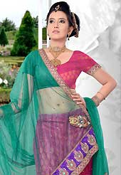Today's fashion is really about sensuality which can be seen in this creation. This deep pink net and brocade lehenga is nicely embroidered patch work is done with zari, sequins, stone and lace work. The beautiful embroidery on lehenga made it awesome and gives you stylish and attractive look to others. Matching choli and green net dupatta is availble with this lehenga. Slight Color variations are possible due to differing screen and photograph resolutions.