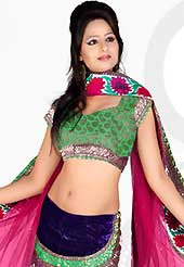 The evolution of style species collection spells pure femininity. This deep pink net and velvet lehenga is nicely embroidered patch work is done with resham, stone and lace work. The beautiful embroidery on lehenga made it awesome and gives you stylish and attractive look to others. Contrasting green choli and deep pink net dupatta is availble with this lehenga. Slight Color variations are possible due to differing screen and photograph resolutions.