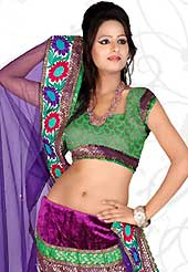 Embroidered lehengas are highly in order on a range of occasions such as wedding, formal party and festivals. This purple net and velvet lehenga is nicely embroidered patch work is done with resham, stone and lace work. The beautiful embroidery on lehenga made it awesome and gives you stylish and attractive look to others. Contrasting green choli and purple net dupatta is availble with this lehenga. Slight Color variations are possible due to differing screen and photograph resolutions.
