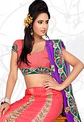 An occasion wear perfect is ready to rock you. This coral art silk lehenga is nicely embroidered patch work is done with resham, zari, sequins and stone work. The beautiful embroidery on lehenga made it awesome and gives you stylish and attractive look to others. Matching choli and purple net dupatta is availble with this lehenga. Slight Color variations are possible due to differing screen and photograph resolutions.