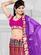 Bold colors created by the inventive drapes of textile catch the imagination like no other contemporary clothing. This purple and light orange net lehenga is nicely embroidered patch work is done with resham, sequins and stone work. The beautiful embroidery on lehenga made it awesome and gives you stylish and attractive look to others. Contrasting pink choli and purple net dupatta is availble with this lehenga. Slight Color variations are possible due to differing screen and photograph resolutions.