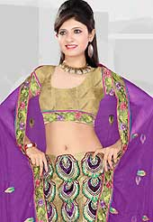 Elegance and innovation of designs crafted for you. This purple and dark beige net and art silk lehenga is nicely embroidered patch work is done with resham, sequins and stone work. The beautiful embroidery on lehenga made it awesome and gives you stylish and attractive look to others. Matching beige choli and purple net dupatta is availble with this lehenga. Slight Color variations are possible due to differing screen and photograph resolutions.