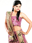 Dreamy variation on shape and forms compliment your style with tradition. This dark pink net lehenga is nicely embroidered patch work is done with cutdana, sequins, zardosi, stone, beads and cutbeads work. The beautiful embroidery on lehenga made it awesome and gives you stylish and attractive look to others. Matching choli and dupatta is availble with this lehenga. Slight Color variations are possible due to differing screen and photograph resolutions.