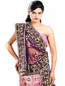 Let your personality speak for you this wedding lehenga embellished with embroidery work. This pink net lehenga is nicely embroidered patch work is done with cutdana, sequins, stone, beads and cutbeads work. The beautiful embroidery on lehenga made it awesome and gives you stylish and attractive look to others. Matching choli and purple net dupatta is availble with this lehenga. Slight Color variations are possible due to differing screen and photograph resolutions.