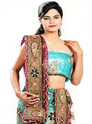 Take a look on the changing fashion of the season. This turquoise blue net lehenga is nicely embroidered and velvet patch work is done with cutdana, sequins, stone, beads and cutbeads work. The beautiful embroidery on lehenga made it awesome and gives you stylish and attractive look to others. Matching choli and dark magenta net dupatta is availble with this lehenga. Slight Color variations are possible due to differing screen and photograph resolutions.