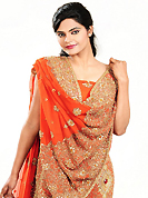 No one like ordinary look, because every woman has their own beauty and our collection gives extra ordinary look to you. This dark orange georgette lehenga is nicely embroidered patch work is done with zari, cutdana, sequins, stone and cutbeads work. The beautiful embroidery on lehenga made it awesome and gives you stylish and attractive look to others. Matching choli and dupatta is availble with this lehenga. Slight Color variations are possible due to differing screen and photograph resolutions.