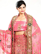 Bold colors created by the inventive drapes of textile catch the imagination like no other contemporary clothing. This pink georgette lehenga is nicely embroidered and velvet patch work is done with zardosi, stone, beads and cutbeads work. The beautiful embroidery on lehenga made it awesome and gives you stylish and attractive look to others. Matching choli and dupatta is availble with this lehenga. Slight Color variations are possible due to differing screen and photograph resolutions.