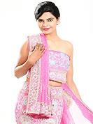 Embroidered lehengas are highly in order on a range of occasions such as wedding, formal party and festivals. This pink crepe silk lehenga is nicely embroidered patch work is done with zardosi, cutdana, stone, beads and cutbeads work. The beautiful embroidery on lehenga made it awesome and gives you stylish and attractive look to others. Matching choli and dupatta is availble with this lehenga. Slight Color variations are possible due to differing screen and photograph resolutions.