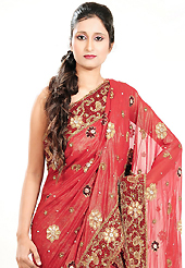 Bold colors created by the inventive drapes of textile catch the imagination like no other contemporary clothing. This red georgette lehenga is nicely embroidered patch work is done with cutdana, stone, beads and cutbeads work. The beautiful embroidery on lehenga made it awesome and gives you stylish and attractive look to others. Matching choli and dupatta is availble with this lehenga. Slight Color variations are possible due to differing screen and photograph resolutions.