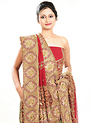 Welcome to the new era of Indian fashion wear. This dark red georgette lehenga is nicely embroidered patch work is done with zardosi, cutdana, stone, beads and cutbeads work. The beautiful embroidery on lehenga made it awesome and gives you stylish and attractive look to others. Matching choli and dupatta is availble with this lehenga. Slight Color variations are possible due to differing screen and photograph resolutions.