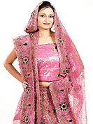 Dreamy variation on shape and forms compliment your style with tradition. This pink georgette lehenga is nicely embroidered and velvet patch work is done with zardosi, cutdana, stone, beads and cutbeads work. The beautiful embroidery on lehenga made it awesome and gives you stylish and attractive look to others. Matching choli and dupatta is availble with this lehenga. Slight Color variations are possible due to differing screen and photograph resolutions.