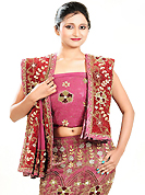 Be the cynosure of all eyes with this wonderful casual wear in flattering colors and combinations. This dark pink georgette lehenga is nicely embroidered and velvet patch work is done with zardosi, cutdana, stone, beads and cutbeads work. The beautiful embroidery on lehenga made it awesome and gives you stylish and attractive look to others. Matching choli and red net dupatta is availble with this lehenga. Slight Color variations are possible due to differing screen and photograph resolutions.