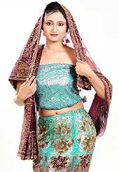 An occasion wear perfect is ready to rock you. This light blue net lehenga is nicely embroidered and velvet patch work is done with zardosi, cutdana, stone, beads and cutbeads work. The beautiful embroidery on lehenga made it awesome and gives you stylish and attractive look to others. Matching choli and burgundy net dupatta is availble with this lehenga. Slight Color variations are possible due to differing screen and photograph resolutions.