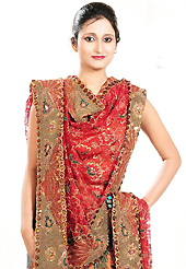 Let your personality speak for you this wedding lehenga embellished with embroidery work. This orange tissue lehenga is nicely embroidered and velvet patch work is done with zardosi, cutdana, stone, beads and cutbeads work. The beautiful embroidery on lehenga made it awesome and gives you stylish and attractive look to others. Matching choli and red net dupatta is availble with this lehenga. Slight Color variations are possible due to differing screen and photograph resolutions.