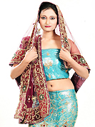 Embroidered lehengas are highly in order on a range of occasions such as wedding, formal party and festivals. This aqua blue net lehenga is nicely embroidered and velvet patch work is done with zardosi, cutdana, stone, beads and cutbeads work. The beautiful embroidery on lehenga made it awesome and gives you stylish and attractive look to others. Matching choli and deep pink net dupatta is availble with this lehenga. Slight Color variations are possible due to differing screen and photograph resolutions.