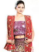 The evolution of style species collection spells pure femininity. This dark purple net lehenga is nicely embroidered and velvet patch work is done with zardosi, cutdana, stone, beads and cutbeads work. The beautiful embroidery on lehenga made it awesome and gives you stylish and attractive look to others. Matching choli and red net dupatta is availble with this lehenga. Slight Color variations are possible due to differing screen and photograph resolutions.