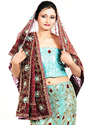 Get ready to sizzle all around you by sparkling lehenga. This light blue net lehenga is nicely embroidered and velvet patch work is done with zardosi, cutdana, stone, beads and cutbeads work. The beautiful embroidery on lehenga made it awesome and gives you stylish and attractive look to others. Matching choli and maroon net dupatta is availble with this lehenga. Slight Color variations are possible due to differing screen and photograph resolutions.
