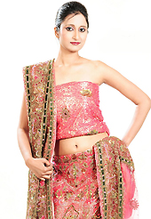 It's cool and has a very modern look to impress all. This pink net lehenga is nicely embroidered patch work is done with cutdana, sequins, stone, beads and cutbeads work. The beautiful embroidery on lehenga made it awesome and gives you stylish and attractive look to others. Matching choli and dupatta is availble with this lehenga. Slight Color variations are possible due to differing screen and photograph resolutions.