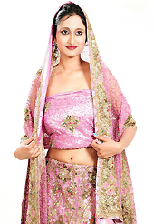 Take a look on the changing fashion of the season. This pink net lehenga is nicely embroidered patch work is done with cutdana, sequins, stone, beads and cutbeads work. The beautiful embroidery on lehenga made it awesome and gives you stylish and attractive look to others. Matching choli and dupatta is availble with this lehenga. Slight Color variations are possible due to differing screen and photograph resolutions.