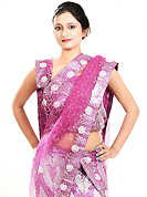 Let your personality speak for you this wedding lehenga embellished with embroidery work. This pink net lehenga is nicely embroidered patch work is done with zardosi, cutdana, sequins, stone, beads and cutbeads work. The beautiful embroidery on lehenga made it awesome and gives you stylish and attractive look to others. Matching choli and dupatta is availble with this lehenga. Slight Color variations are possible due to differing screen and photograph resolutions.