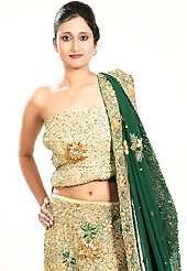 Make your collection more attractive and charming with this impressive dress. This dark cream georgette lehenga is nicely embroidered patch work is done with zardosi, cutdana, stone, beads and cutbeads work. The beautiful embroidery on lehenga made it awesome and gives you stylish and attractive look to others. Matching choli and green dupatta is availble with this lehenga. Slight Color variations are possible due to differing screen and photograph resolutions.