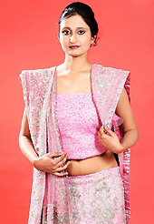 An occasion wear perfect is ready to rock you. This pink net lehenga is nicely embroidered patch work is done with zardosi, cutdana, stone, beads and cutbeads work. The beautiful embroidery on lehenga made it awesome and gives you stylish and attractive look to others. Matching choli and dupatta is availble with this lehenga. Slight Color variations are possible due to differing screen and photograph resolutions.