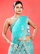 Dreamy variation on shape and forms compliment your style with tradition. This light blue net lehenga is nicely embroidered patch work is done with zardosi, cutdana, sequins, stone, beads and cutbeads work. The beautiful embroidery on lehenga made it awesome and gives you stylish and attractive look to others. Matching choli and dupatta is availble with this lehenga. Slight Color variations are possible due to differing screen and photograph resolutions.