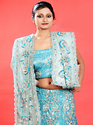 Today's fashion is really about sensuality which can be seen in this creation. This blue net lehenga is nicely embroidered patch work is done with zardosi, cutdana, sequins, stone, beads and cutbeads work. The beautiful embroidery on lehenga made it awesome and gives you stylish and attractive look to others. Matching choli and dupatta is availble with this lehenga. Slight Color variations are possible due to differing screen and photograph resolutions.