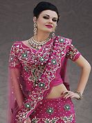 Elegance and innovation of designs crafted for you. This dark pink net lehenga choli is nicely embroidery and velvet patch work is done with stone, zardosi, cutdana, beads and cutbeads work. All over embroidery work on lehenga is stunning. The beautiful heavy embroidery on lehenga made it awesome and gives you stylish and attractive look to others. Matching choli and dupatta is availble with this lehenga. Slight Color variations are possible due to differing screen and photograph resolutions.