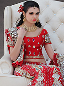 Outfit is a novel ways of getting yourself noticed. This red net lehenga choli is nicely embroidery and velvet patch work is done with resham, stone, zardosi, cutdana, beads and cutbeads work. All over embroidery work on lehenga is stunning. The beautiful heavy embroidery on lehenga made it awesome and gives you stylish and attractive look to others. Matching choli and dupatta is availble with this lehenga. Slight Color variations are possible due to differing screen and photograph resolutions.