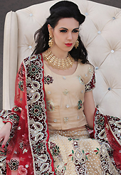 Be the cynosure of all eyes with this wonderful casual wear in flattering colors and combinations. This beige net lehenga choli is nicely embroidery and velvet patch work is done with resham, stone, zardosi, cutdana, beads and cutbeads work. All over embroidery work on lehenga is stunning. The beautiful heavy embroidery on lehenga made it awesome and gives you stylish and attractive look to others. Matching choli and red net dupatta is availble with this lehenga. Slight Color variations are possible due to differing screen and photograph resolutions.