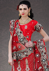 Dreamy variation on shape and forms compliment your style with tradition. This red net lehenga choli is nicely embroidery and velvet patch work is done with stone, zardosi, cutdana, beads and cutbeads work. All over embroidery work on lehenga is stunning. The beautiful heavy embroidery on lehenga made it awesome and gives you stylish and attractive look to others. Matching choli and dupatta is availble with this lehenga. Slight Color variations are possible due to differing screen and photograph resolutions.