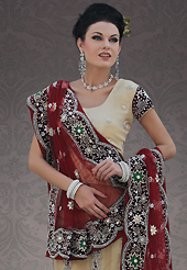 It's cool and has a very modern look to impress all. This dark cream net lehenga choli is nicely embroidery and velvet patch work is done with stone, cutdana and cutbeads work. All over embroidery work on lehenga is stunning. The beautiful heavy embroidery on lehenga made it awesome and gives you stylish and attractive look to others. Matching choli and maroon net dupatta is availble with this lehenga. Slight Color variations are possible due to differing screen and photograph resolutions.
