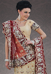 Take a look on the changing fashion of the season. This beige net lehenga choli is nicely embroidery and velvet patch work is done with stone, zardosi, cutdana, beads and cutbeads work. All over embroidery work on lehenga is stunning. The beautiful heavy embroidery on lehenga made it awesome and gives you stylish and attractive look to others. Matching choli and dark red net dupatta is availble with this lehenga. Slight Color variations are possible due to differing screen and photograph resolutions.