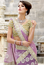 It's cool and has a very modern look to impress all. This mauve and yellow net lehenga choli is nicely embroidered patch work is done with resham, zari, stone and lace work. All over embroidery work on lehenga is stunning. The beautiful heavy embroidery on lehenga made it awesome and gives you stylish and attractive look to others. Matching yellow choli and mauve net dupatta is availble with this lehenga. Accessories shown in the image is just for photography purpose. Slight Color variations are possible due to differing screen and photograph resolutions.