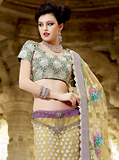 Outfit is a novel ways of getting yourself noticed. This light yellow and light purple net lehenga choli is nicely embroidered patch work is done with resham, zari, sequins, stone and lace work. All over embroidery work on lehenga is stunning. The beautiful heavy embroidery on lehenga made it awesome and gives you stylish and attractive look to others. Contrasting turquoise green choli and light yellow net dupatta is availble with this lehenga. Accessories shown in the image is just for photography purpose. Slight Color variations are possible due to differing screen and photograph resolutions.