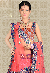No one like ordinary look, because every woman has their own beauty and our collection gives extra ordinary look to you. This pink net a-line lehenga is nicely embroidered patch work is done with resham, zari, sequins and stone work. The beautiful embroidery on lehenga made it awesome and gives you stylish and attractive look to others. Matching choli and dupatta is availble with this lehenga. Slight Color variations are possible due to differing screen and photograph resolutions.