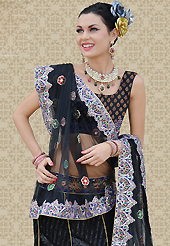 Today's fashion is really about sensuality which can be seen in this creation. This black net a-line lehenga is nicely embroidered patch work is done with resham, zari, sequins and stone work. The beautiful embroidery on lehenga made it awesome and gives you stylish and attractive look to others. Matching choli and dupatta is availble with this lehenga. Slight Color variations are possible due to differing screen and photograph resolutions.