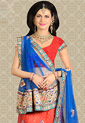 Dreamy variation on shape and forms compliment your style with tradition. This light red net a-line lehenga is nicely embroidered patch work is done with resham, zari, stone and lace work. The beautiful embroidery on lehenga made it awesome and gives you stylish and attractive look to others. Matching choli and blue net dupatta is availble with this lehenga. Slight Color variations are possible due to differing screen and photograph resolutions.