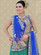 Bold colors created by the inventive drapes of textile catch the imagination like no other contemporary clothing. This green net a-line lehenga is nicely embroidered patch work is done with resham, zari, stone and lace work. The beautiful embroidery on lehenga made it awesome and gives you stylish and attractive look to others. Matching choli and blue net dupatta is availble with this lehenga. Slight Color variations are possible due to differing screen and photograph resolutions.
