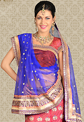 An occasion wear perfect is ready to rock you. This dark pink net a-line lehenga is nicely embroidered patch work is done with resham, zari, stone and lace work. The beautiful embroidery on lehenga made it awesome and gives you stylish and attractive look to others. Matching choli and blue net dupatta is availble with this lehenga. Slight Color variations are possible due to differing screen and photograph resolutions.
