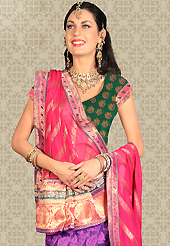 Make your collection more attractive and charming with this impressive dress. This purple net a-line lehenga is nicely embroidered patch work is done with resham, zari, stone and lace work. The beautiful embroidery on lehenga made it awesome and gives you stylish and attractive look to others. Contrasting green choli and pink net dupatta is availble with this lehenga. Slight Color variations are possible due to differing screen and photograph resolutions.