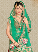 Let your personality speak for you this wedding lehenga embellished with embroidery work. This maroon net a-line lehenga is nicely embroidered patch work is done with resham, zari, stone and lace work. The beautiful embroidery on lehenga made it awesome and gives you stylish and attractive look to others. Matching choli and green net dupatta is availble with this lehenga. Slight Color variations are possible due to differing screen and photograph resolutions.