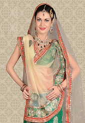 Embroidered lehengas are highly in order on a range of occasions such as wedding, formal party and festivals. This green net a-line lehenga is nicely embroidered patch work is done with resham, zari, stone and lace work. The beautiful embroidery on lehenga made it awesome and gives you stylish and attractive look to others. Matching choli and cream net dupatta is availble with this lehenga. Slight Color variations are possible due to differing screen and photograph resolutions.