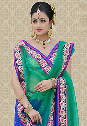 Get ready to sizzle all around you by sparkling lehenga. This blue net a-line lehenga is nicely embroidered patch work is done with resham, zari and stone work. The beautiful embroidery on lehenga made it awesome and gives you stylish and attractive look to others. Matching choli and green net dupatta is availble with this lehenga. Slight Color variations are possible due to differing screen and photograph resolutions.